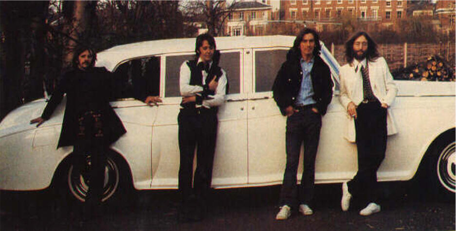 Here is John Lennon's 1965 Rolls-Royce Phantom V with the Beatles before